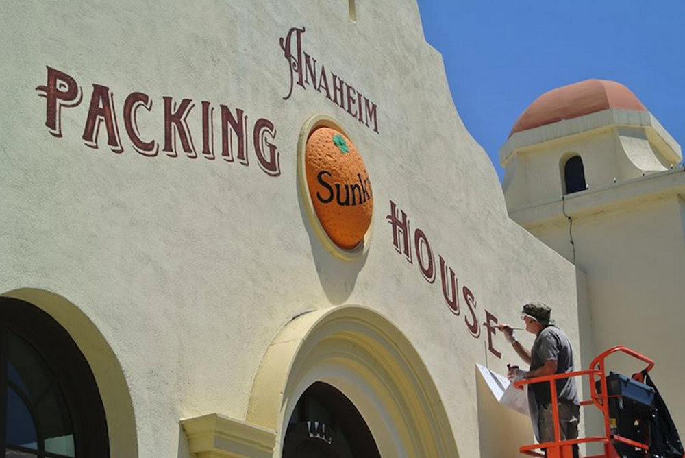 Anaheim Packing House hand lettered main sign - sign painter at work