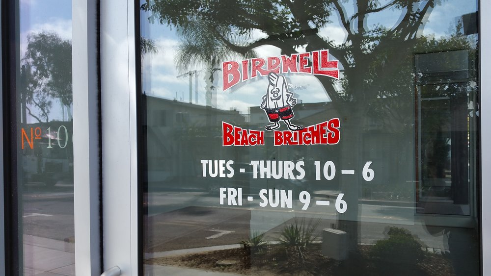 Birdwell Beach Britches hand lettered window sign detail