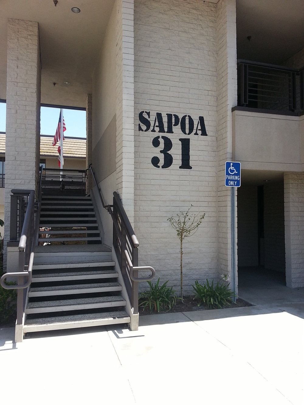 SAPOA exterior hand painted wall graphic