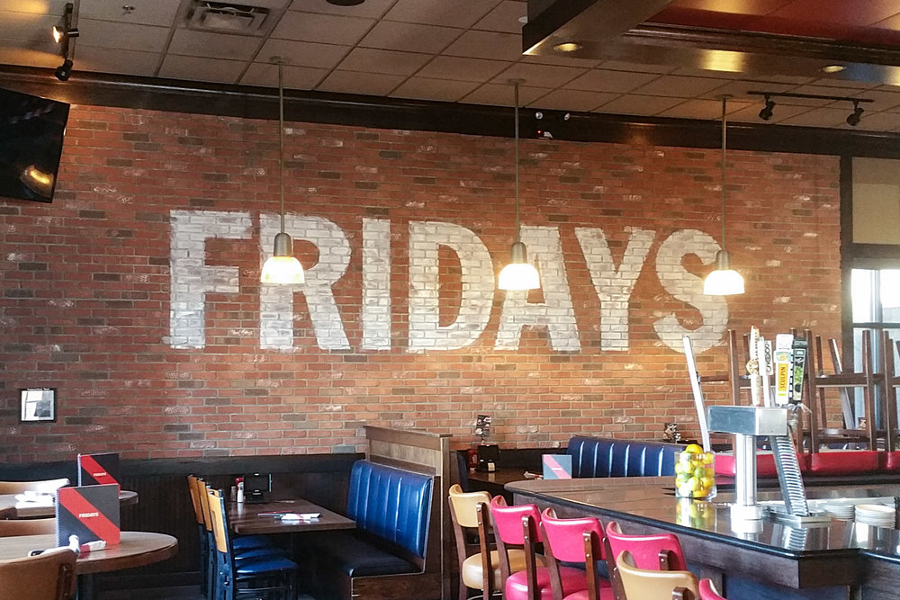 TGI Fridays hand painted ghost sign