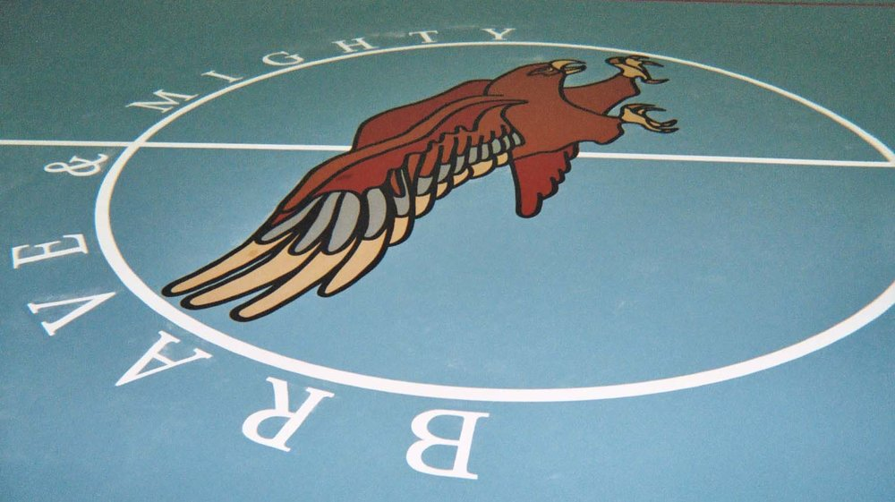 El Cerrito Middle School gym epoxy floor hand painted graphics