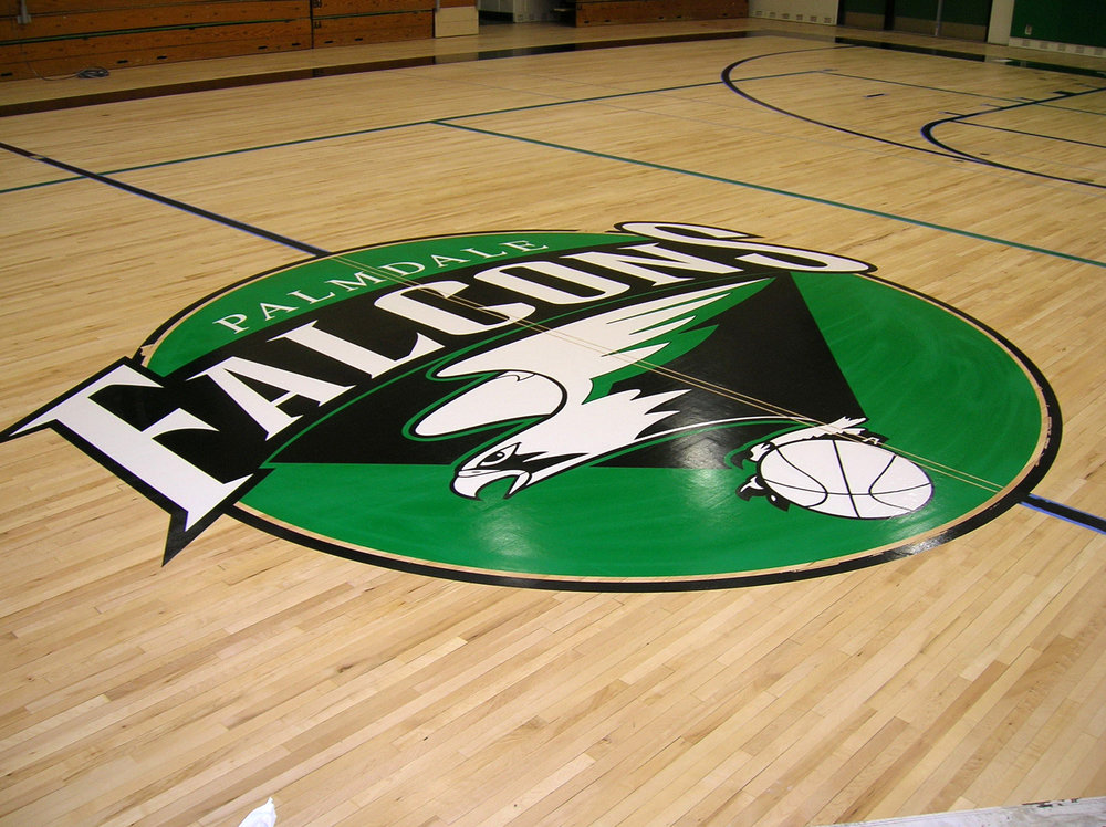 Palmdale High School gym wood floor hand painted graphics