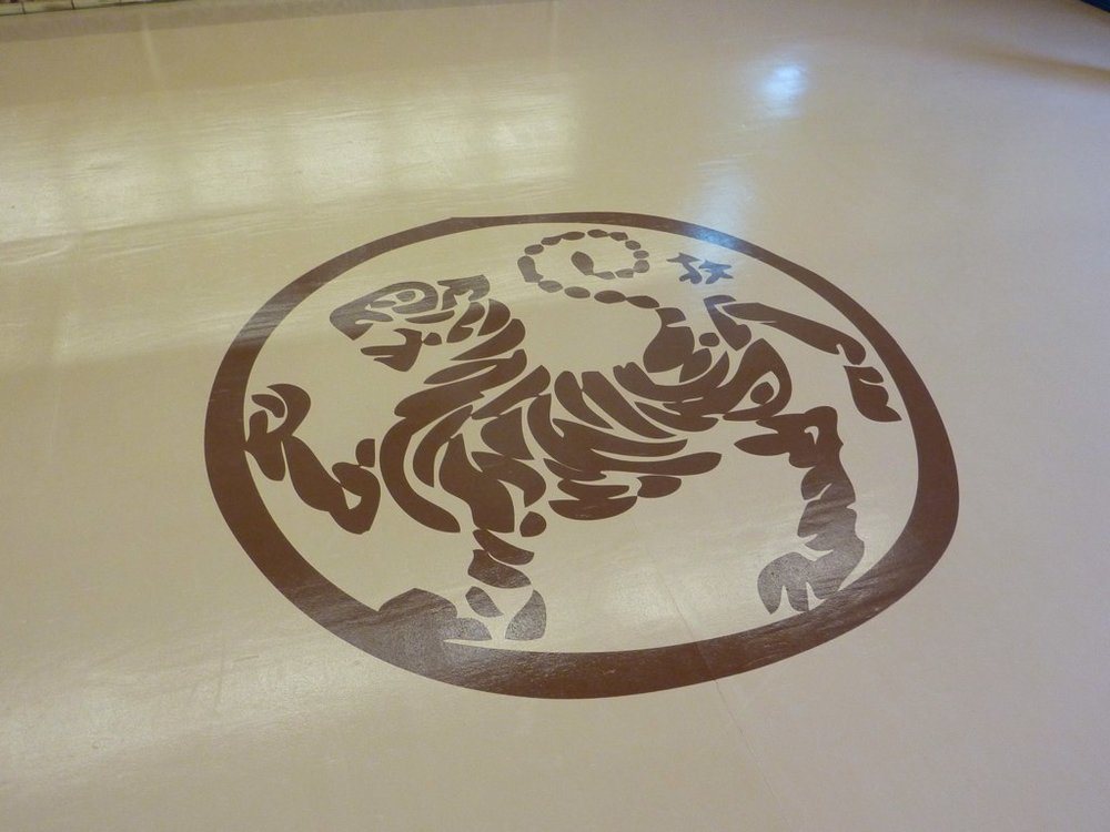 Lake Forest Shotokan dojo gym epoxy floor hand painted graphics