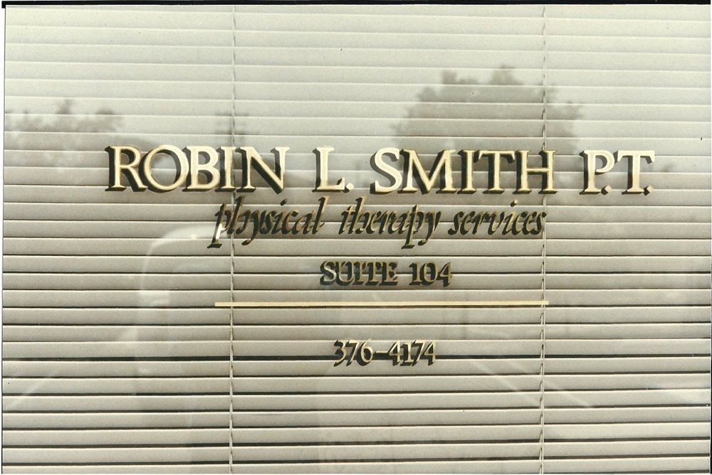 Robin Smith Physical Therapy gold leaf office window sign