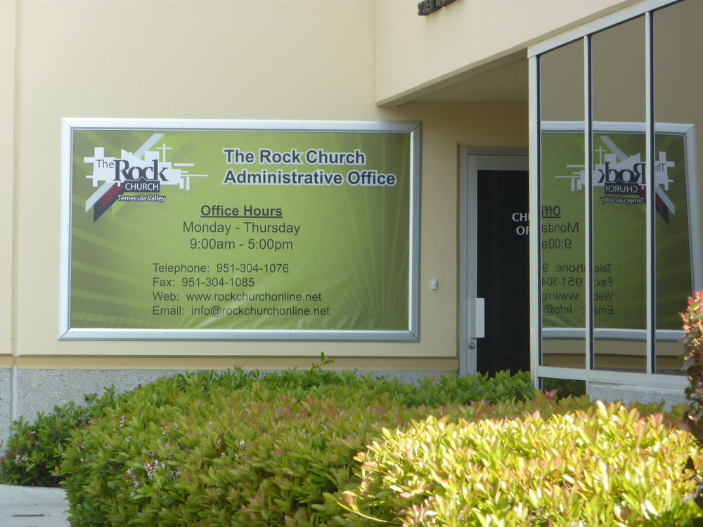 Custom digitally printed banner in wall mounted display frame