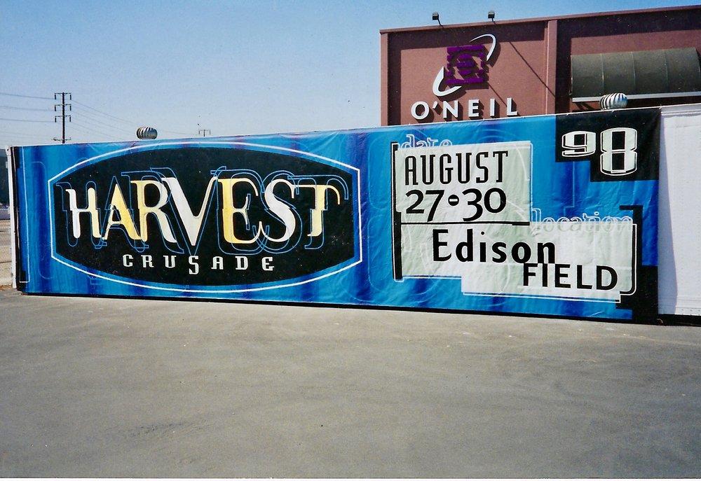 Harvest Crusade freeway custom advertising banner 1998 - hand painted banner - Pre-digital hand painted advertising installed in Santa Ana, Orange County CA.