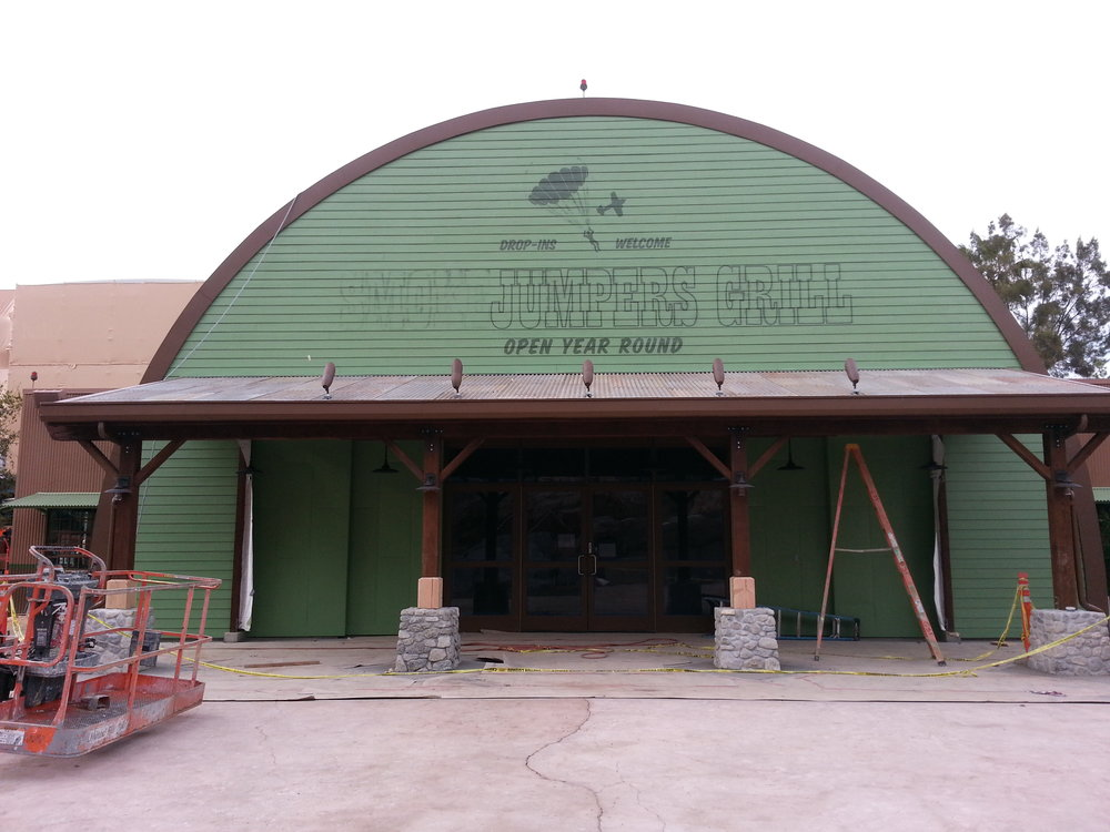 Smokejumpers Grill, California Adventure, Anaheim CA - exterior hand painted graphics - progress… the paint goes on!