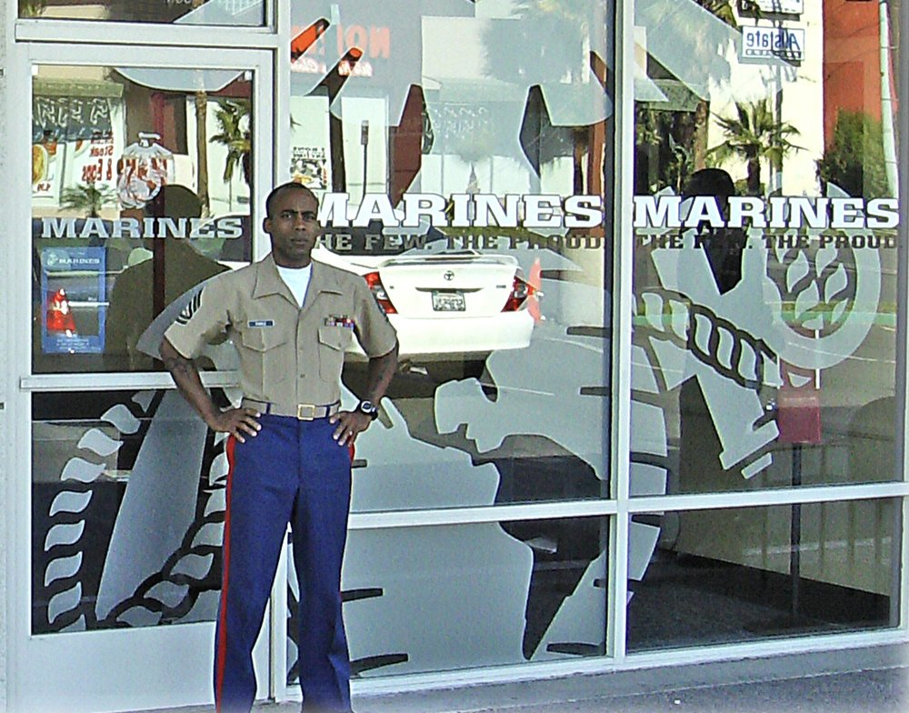 The first prototype was located in Riverside CA, in Southern California. Here is the storefront — the world-famous Marine Corps EGA was applied in etched-look vinyl inside the glass, with computer cut vinyl name and slogan on the outside.