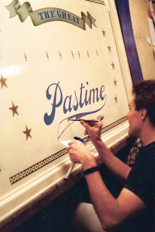 Mr. Big City, sign painter - hand painting this Disneyland Main Street sign