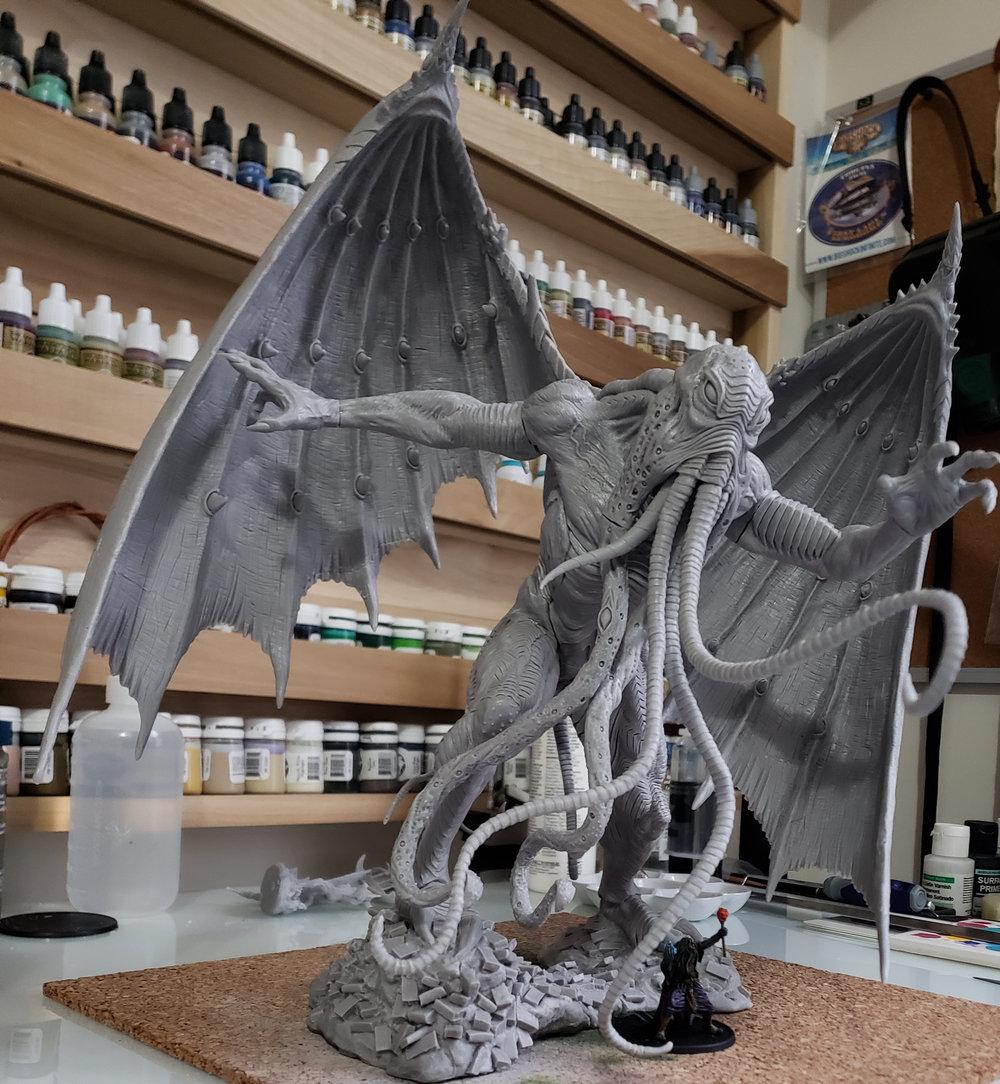 Avatar of Cthulhu along side a standard 32mm miniature.