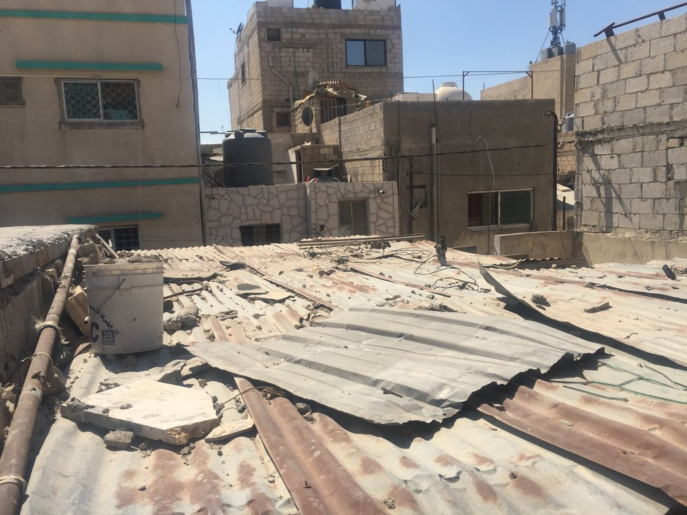 Fixing a Roof - We are on a mission to fix roofs in Zarqa Refugee Camp