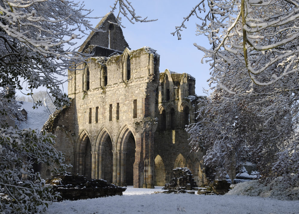 Much Wenlock Priory Ruins in beautiful snowy landscape