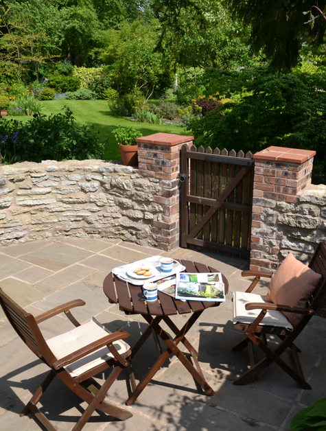 Tea time on the cottage patio with garden view