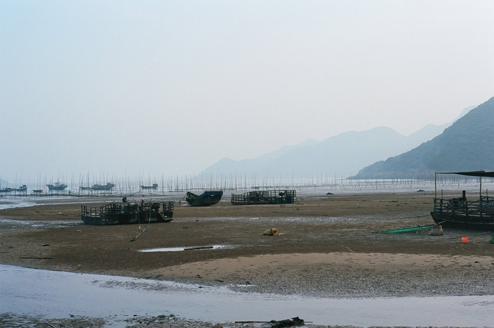 xiapu, fujian. rural fishermen's boats out on the mudflat.