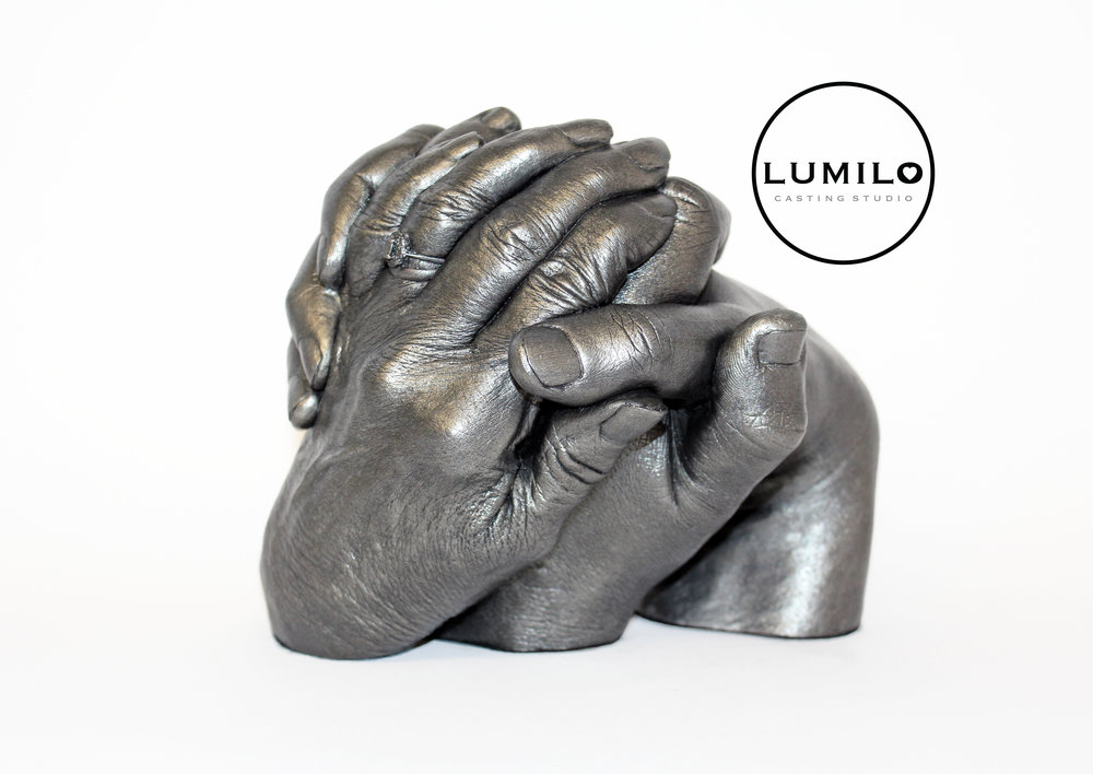 £325 - Three Hands in a Clasped Style start at £250, finished in White Gloss. We also offer the Antique Silver, Gold or Bronze finishes which are our most popular, and are priced above. These come freestanding, and include one ring per adult hand.