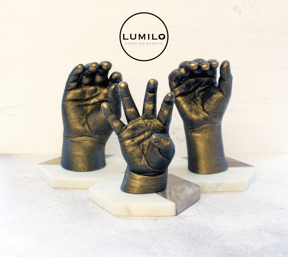£270 - Three siblings hands in a freestanding style (bases are priced individually) with a choice of Antique Silver, Gold or Bronze finish. Prices vary depending on age.