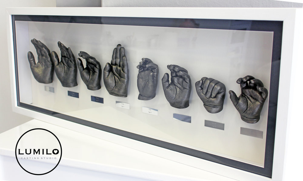 £720 - For something really special we can do a large family framed cast which can include an unlimited number of hands. The cost varies widely depending on the age of the children and how many hands there is. This casting was £720, and featured the hands of 8 Grandchildren between the ages of 13, and 2, with an Antique Silver finish. This includes a bespoke frame with a choice of frame colours and mount options.*All framed castings featuring more than 3 hands include engraved personalised plates at no extra cost.