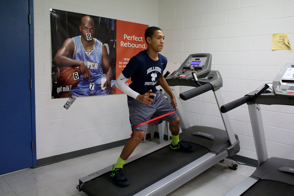 Hillside's Rasheed Harris trains on a treadmill during a weight room and practice session, Sept. 14, 2016, at the school.