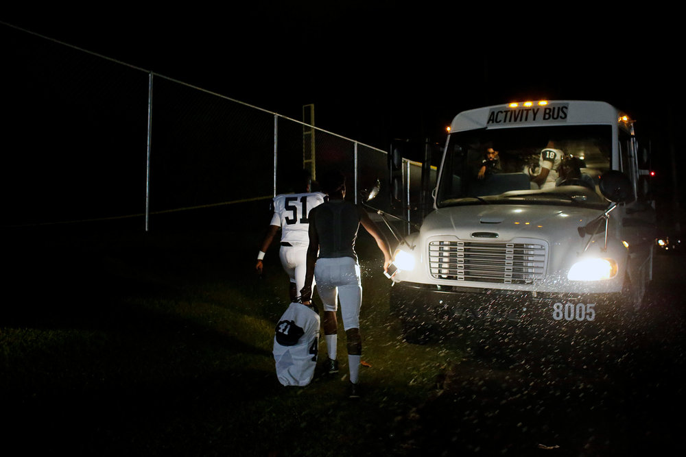 Hillside players walk back to their team bus after a game against Cardinal Gibbons High School, Oct. 6, 2016, at Cardinal Gibbons High School in Raleigh, N.C.