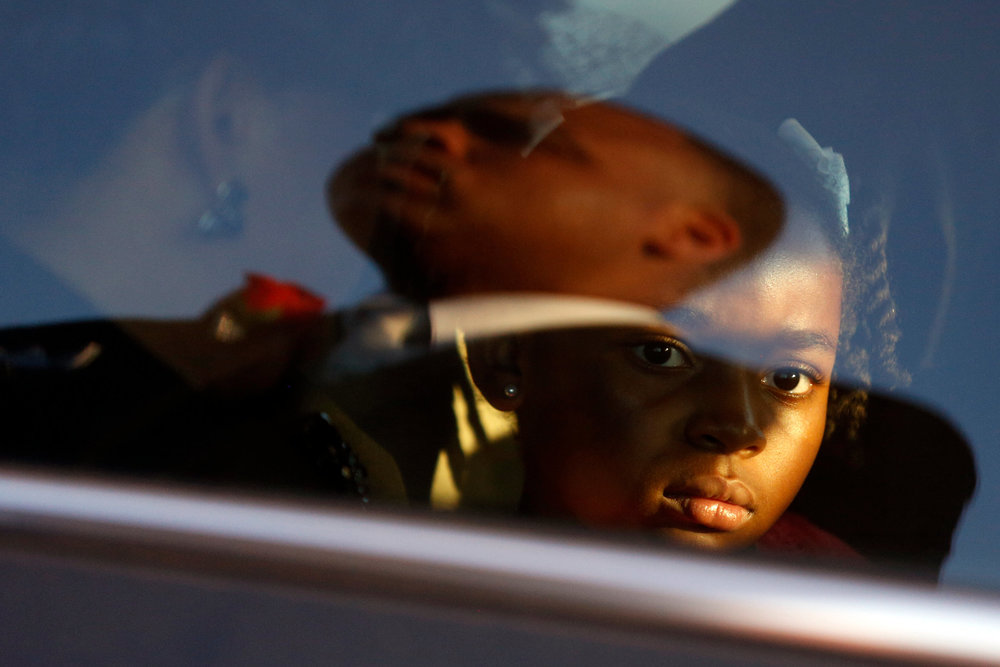 Clementa Pinckney's youngest daughter, Malana, stares out the window of  a vehicle immediately after his burial service. The burial services for Pinckney, who was a pastor and S.C. state senator, were held Friday, June 26, 2015, in a cemetery off of SC-41 in Marion, S.C. Pinckney was one of nine people killed in a June 17 shooting at the Emanuel African Methodist Episcopal Church in Charleston.