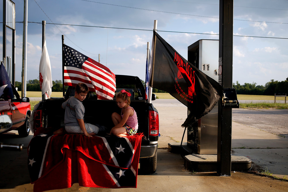 Supporters of the Confederate flag held a rally Saturday, August 1, 2015, off of Harry Byrd Highway in Darlington, S.C. The group was part of a parade of flag-flying vehicles that made its way to the Florence Civic Center, where more than 100 participants gathered in a nearby parking lot. The rally there was shut down by the police, because the group didn't have a permit.