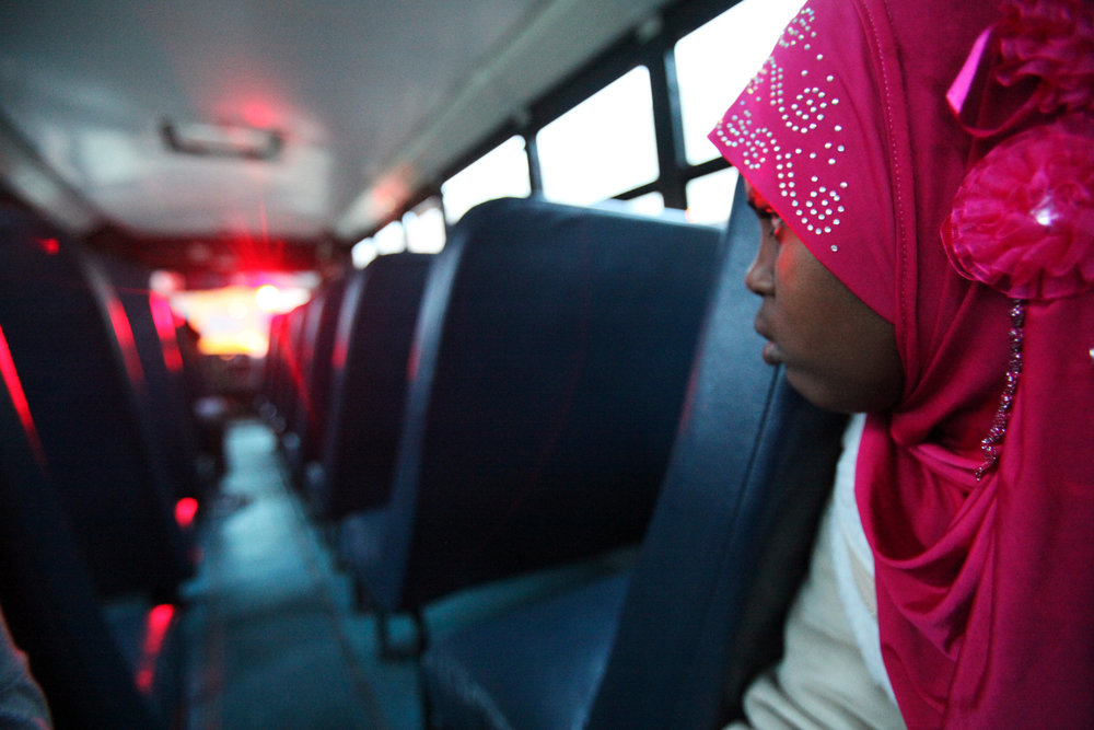 Fadumo Farah Abdi waits to exit the school bus one morning at Bend Gate Elementary School.