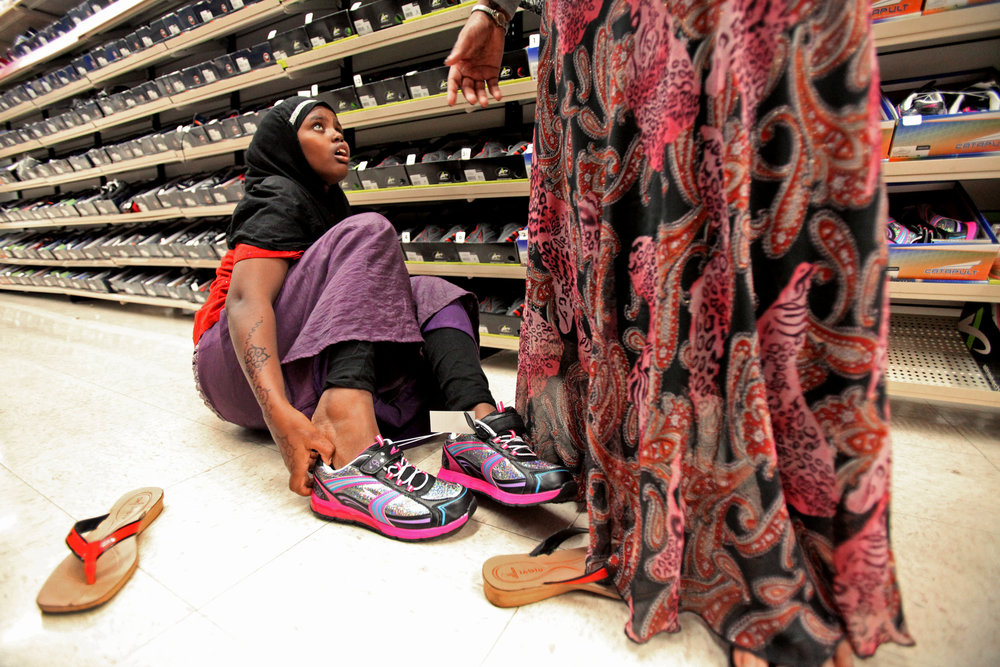 Fadumo Abdi tries on sneakers in Kmart. The following day she complained that her feet hurt.