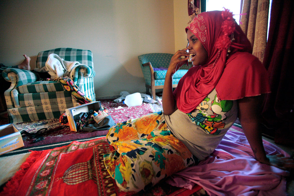Fadumo Farah Abdi calls her friend, Emily Hope, after praying at home.