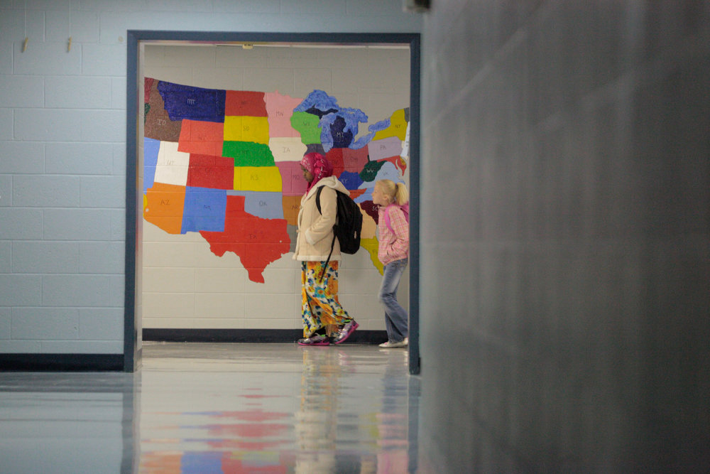 Fadumo walks to class after reciting the Pledge of Allegiance one morning at Bend Gate Elementary School.