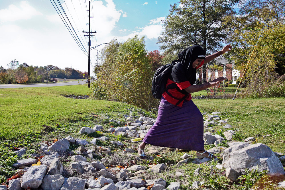 After school, Fadumo Farah Abdi runs from the bus stop to her apartment. While Fadumo's house is just over the boundary in a different school district, teachers and administrators kept her at Henderson's Bend Gate Elementary, the same school her older cousin attended.