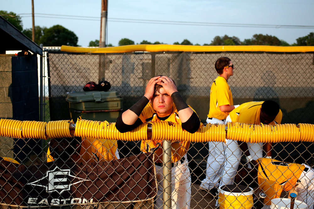 Dillon High School's Kaleb Page stands in his team's dugout after losing to Ninety Six High School in game two of the Class 2A championship series on Wednesday night, May 20, 2015, at Dillon Memorial Stadium. Ninety Six won, 6-3, to win the 2A state championship.