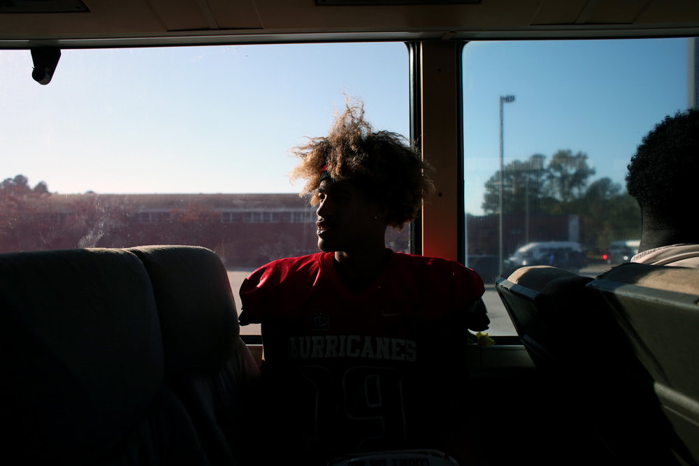 Louisburg College's Javon Harbison rides on his team's bus after a game against Hocking College, Oct. 29, 2016, at James Robert Patterson Memorial Field in Louisburg, N.C. The team takes a bus to all their games since they don't have a field of their own; they play at the local high school field. The Hurricanes are one of the few two-year junior college football teams in the region. The Hurricanes won, 52-40.
