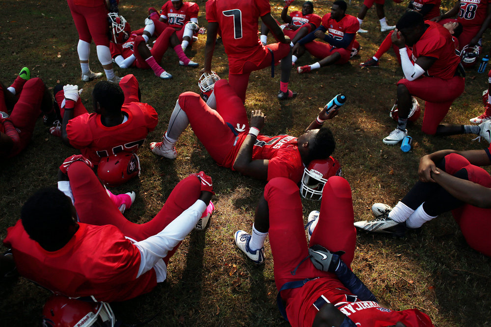 Louisburg College players rest during halftime of an Oct. 29 game against Hocking College. The Hurricanes are one of the few two-year junior college football teams in the region. The Hurricanes took on the Hocking College (Ohio) Hawks on Oct. 29 at James Robert Patterson Memorial Field in Louisburg, N.C. The Hurricanes won, 52-40.