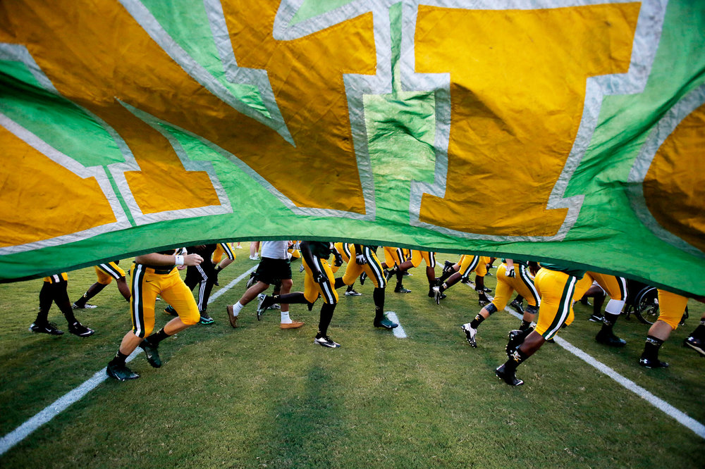 West Florence High School players run onto the field prior to a game against Myrtle Beach High School on Thursday night, September 4, 2014, at Florence's Memorial Stadium.