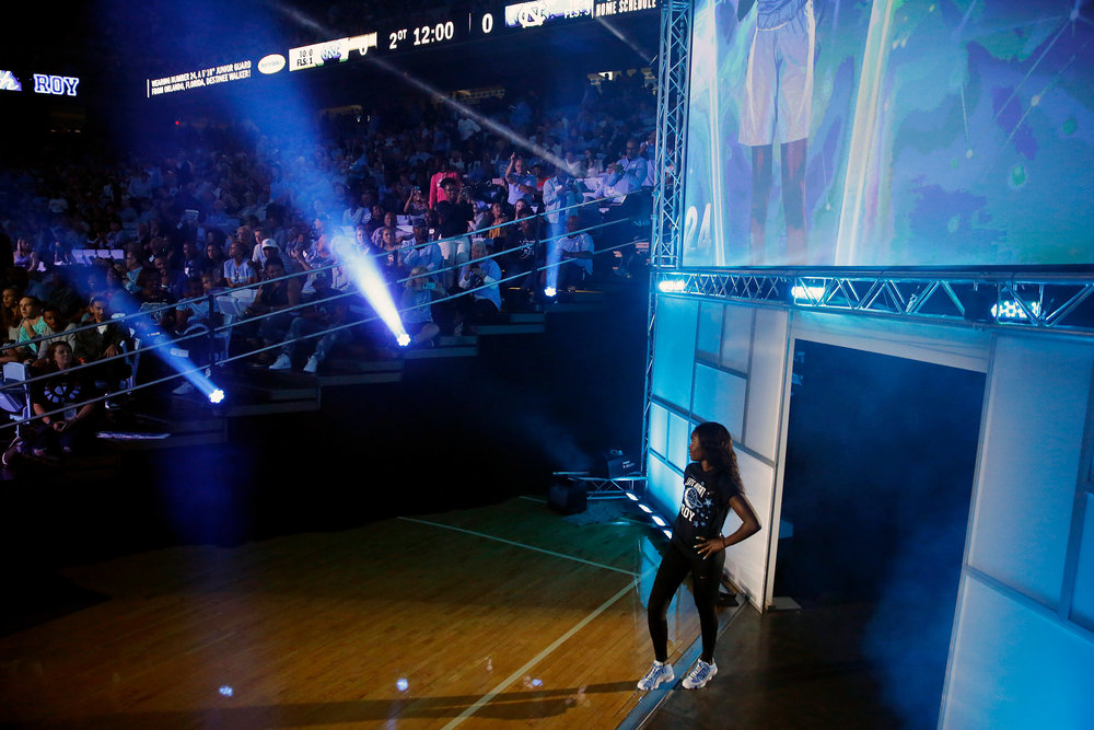 "University of North Carolina's Destinee Walker takes the court to join her basketball teammates during Late Night with Roy, Friday, Oct. 13, 2017, at the Dean E. Smith Center in Chapel Hill, N.C. The pep rally marked the ceremonial start of UNC's basketball season and took place the same day the NCAA announced it would not penalize the school for a ""shadow curriculum"" of fake classes that disproportionately enrolled athletes."