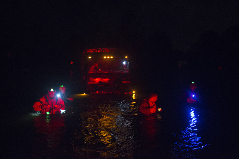 Members of the North Carolina National Guard and New Bern Police Department rescue a tactical vehicle stuck in floodwaters during night operations, Sept. 14 in New Bern, N.C.