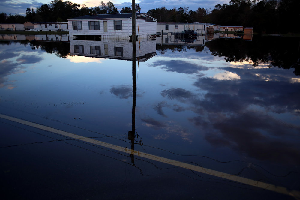 Night falls on Highway 41 as flooding from the nearby Musselshell Creek -- a tributary of the Trent River -- persists, Sept. 18, in Trenton, N.C.