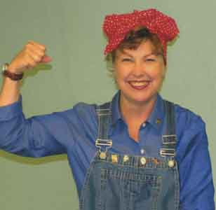 "Rosie the Riveter PORTRAYED BY ELIZABETH MICHAELS - Rosie the Riveter has been a popular American cultural icon for many years. A song of the same name was written by Redd Evans and John Jacob Loeb and was recorded by Kay Kyser's band. J. Howard Miller's ""We Can Do it"" poster (mistaken for Rosie) is still popular, as is Norman Rockwell's Saturday Evening Post cover featuring the strong, capable woman.  In times of war, women are called upon to take on tasks traditionally considered men's work and have shown themselves more than equal to the challenge. Even more difficult might have been returning to traditionally female roles once the men return home. Rosie has symbolized rising to both types of challenges.Elizabeth Michaels' Rosie the Riveter shows the characteristic strength and grace under pressure for which this American archetype is famous. This self-taught actress has created a successful career and family by identifying her talents and finding ways to make her contribution.""I've been privileged to see many Broadway and other professional shows…your talent, confidence, and stage presence delightfully compares with the best that I've seen."" –W.W. LuLu Legion of Honor"