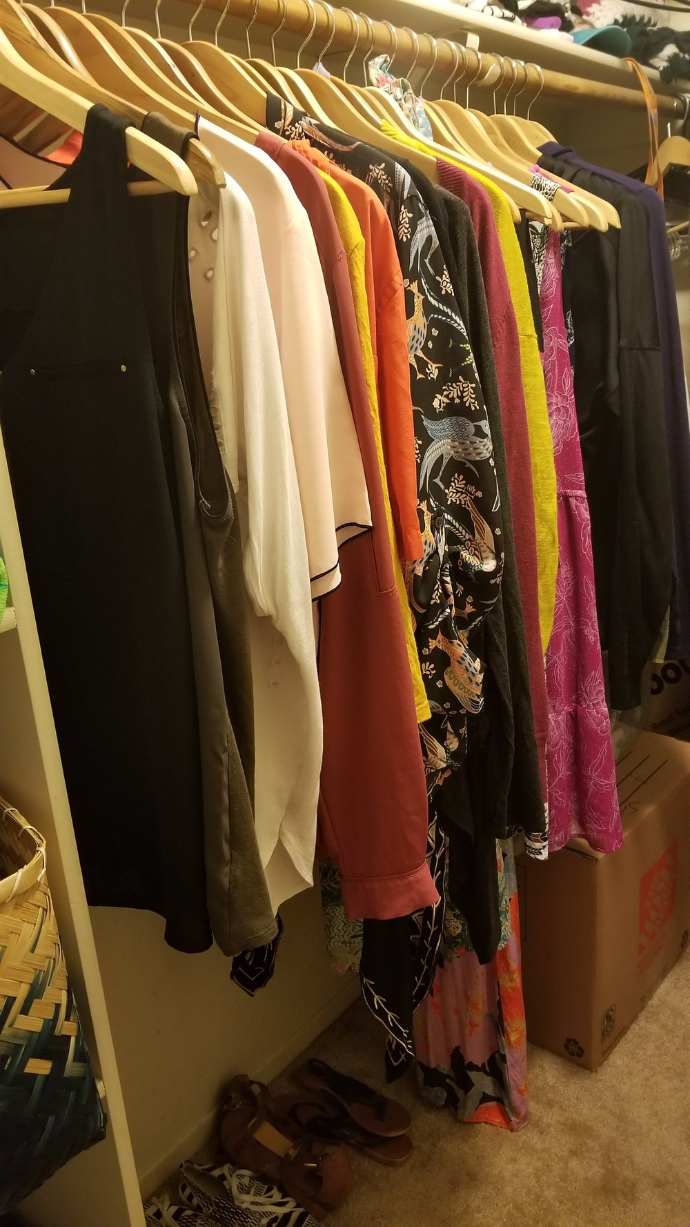 Weekly clothes stay on my closet rack while my out-of-season wear is packed away in a box close by