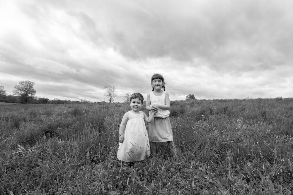Two sisters in a field in Germantown, NY.Photograph by Laughing Heart Photography.