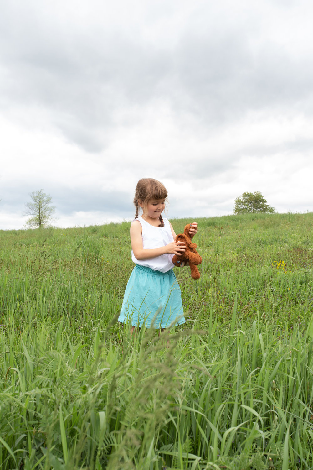 Girl in a field in Germantown, NY.Photograph by Laughing Heart Photography.