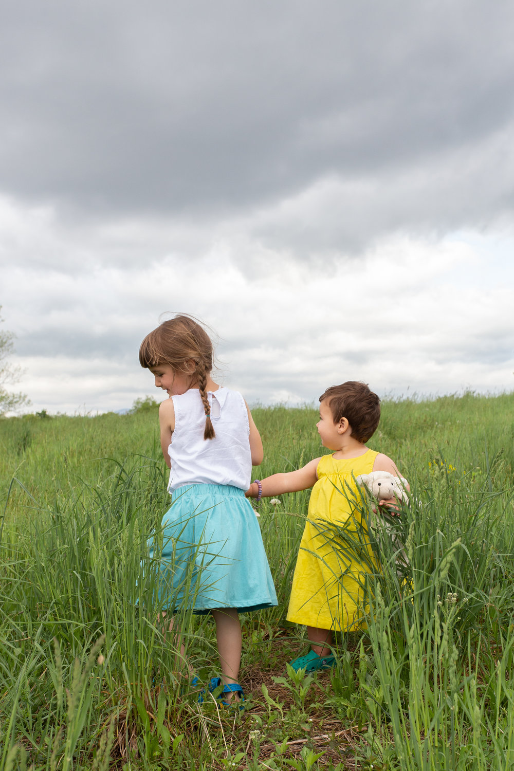 Sisters in a field in Germantown, NY.Photograph by Laughing Heart Photography.