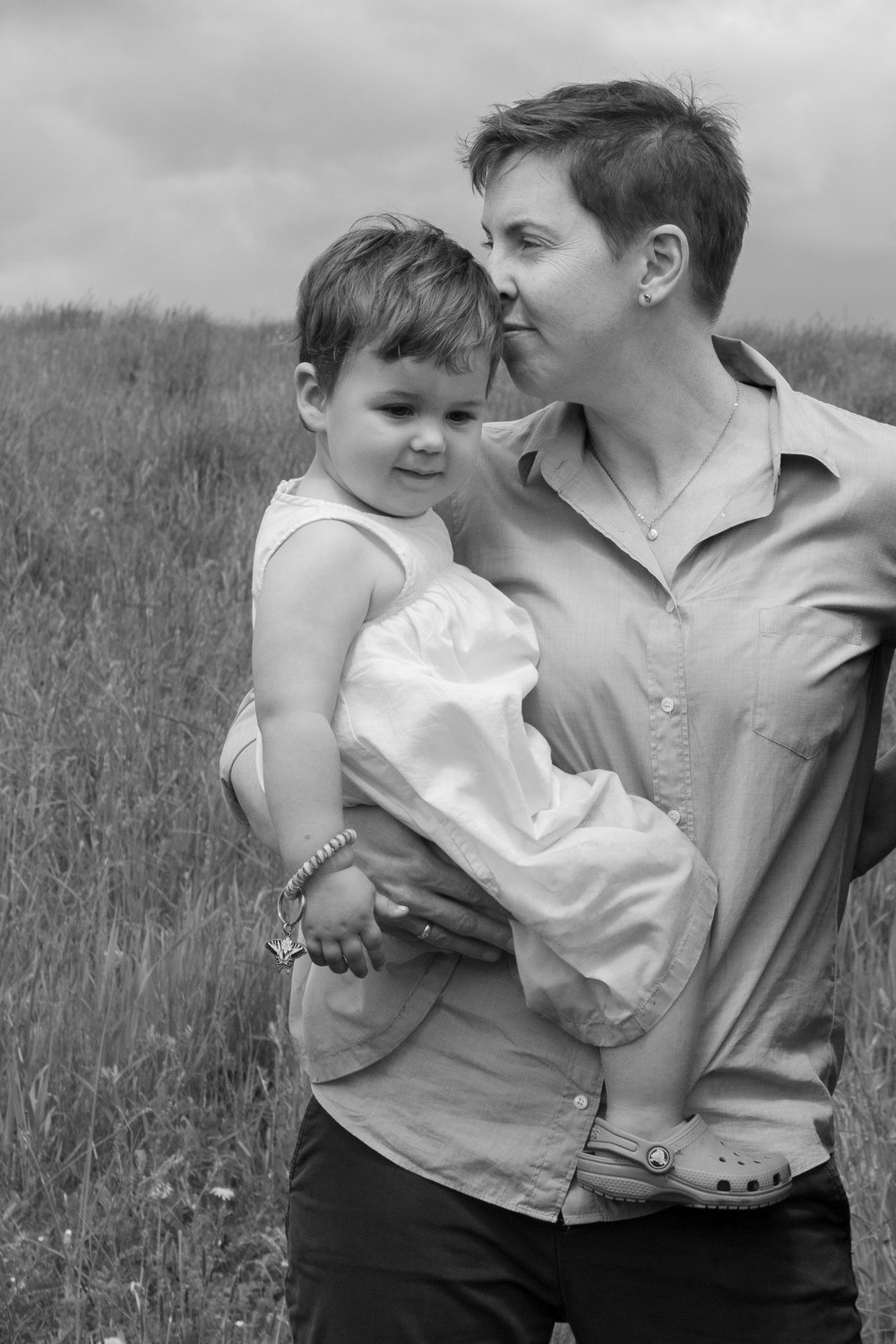 Mom with her daughter in a field in Germantown, NY.Photograph by Laughing Heart Photography.