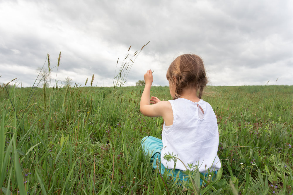 Girl playing in a field in Germantown, NY.Photograph by Laughing Heart Photography.