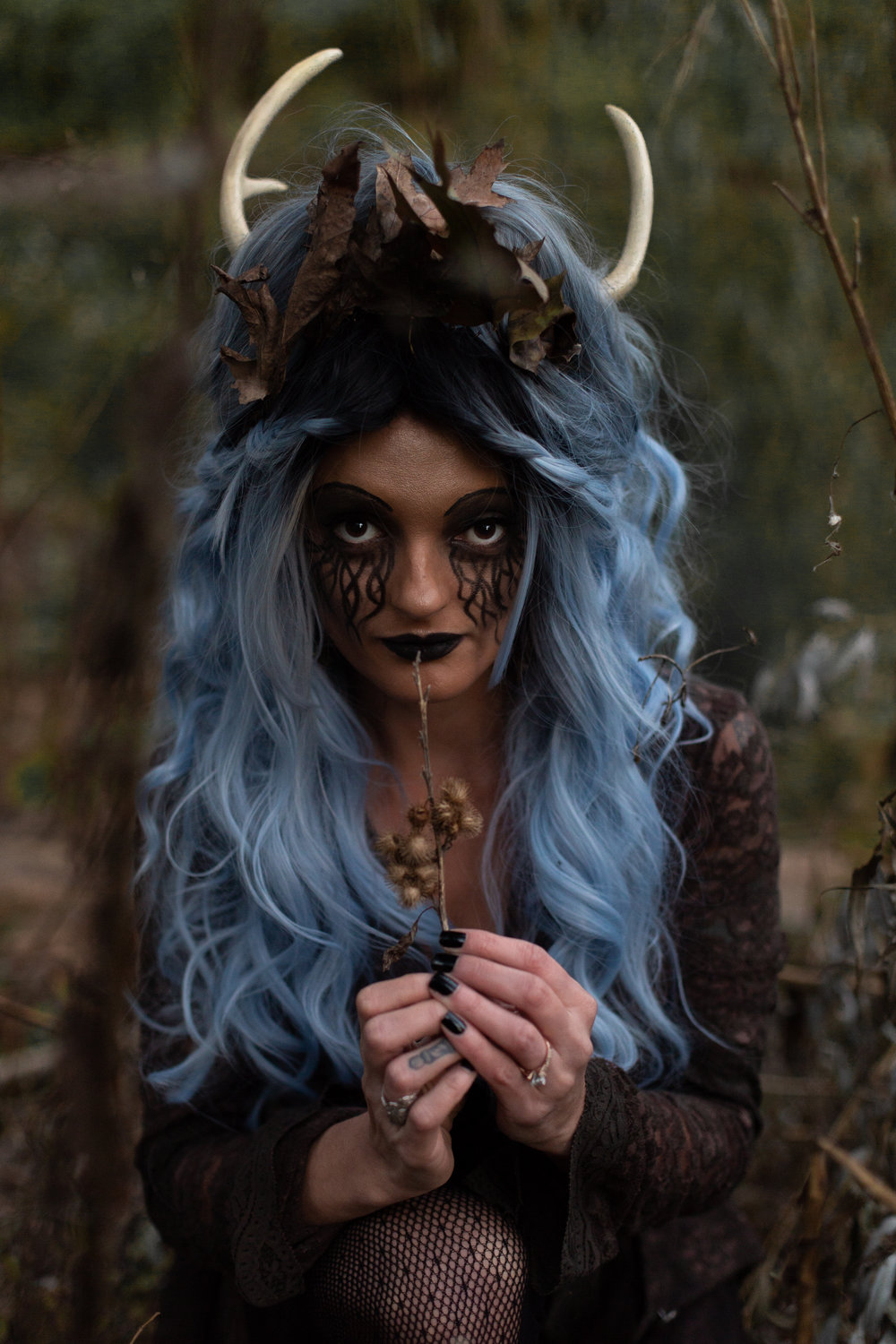 Woman with blue hair and antlers in Ridgewood, New Jersey for Halloween. Photo by Laughing Heart Photography.