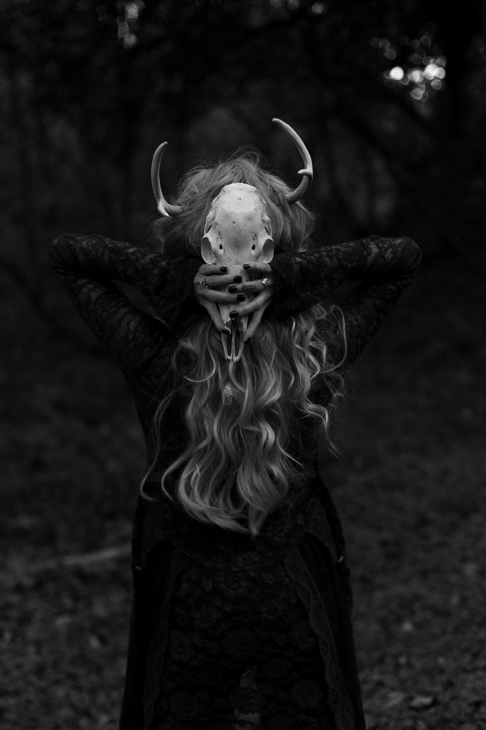 Woman with skull and antlers in Ridgewood, New Jersey for Halloween. Photo by Laughing Heart Photography.