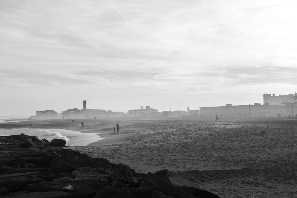 people on beach in Asbury Park, New Jersey. Photo by Kayleigh Ann Archbold.