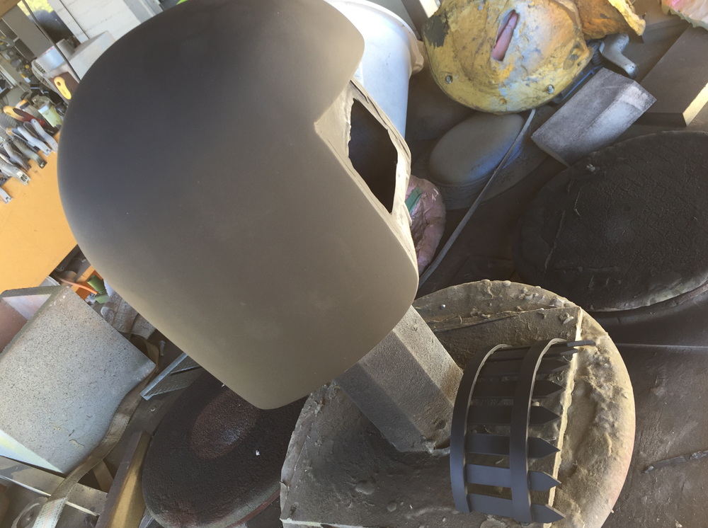 The final helmet and visor get a coat of primer.