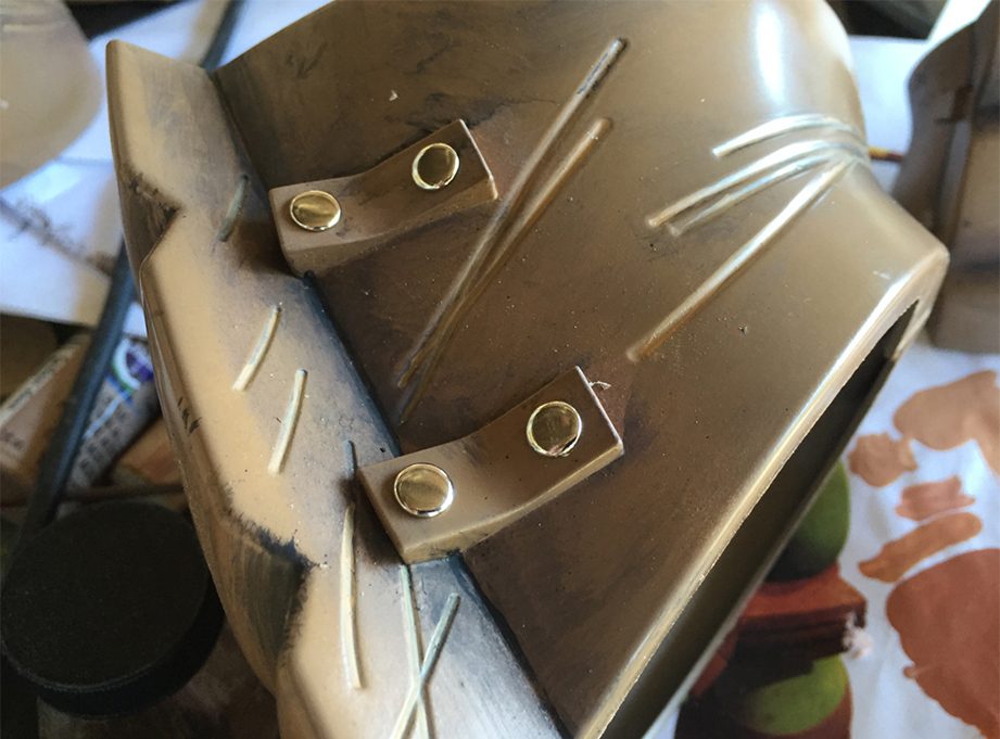 I added metal rivets to the elbow pads since they neglected that detail.