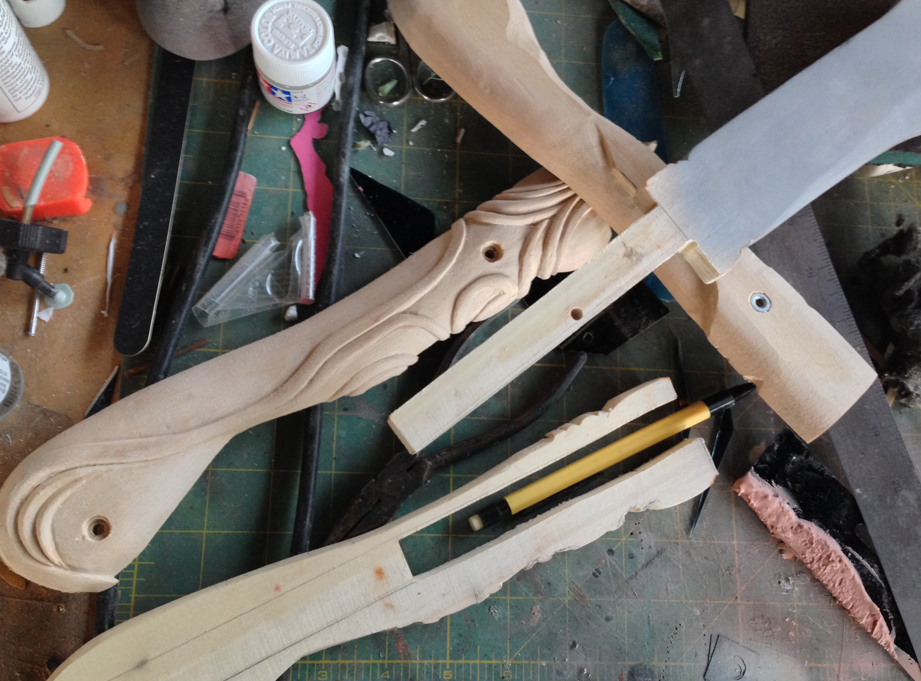 Carving the hilt while the blade was attached was cumbersome so I cut out a tang for the blade from the middle slice.